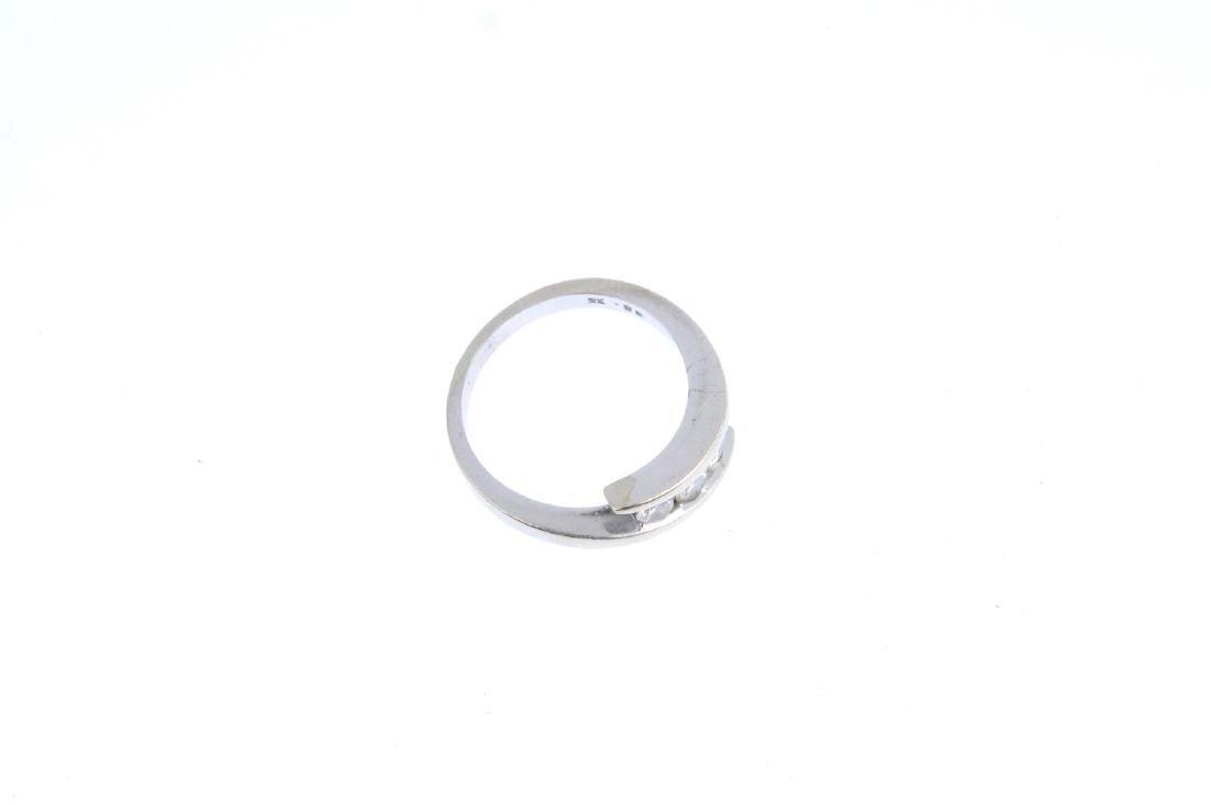 A 9ct gold diamond three-stone ring. The brilliant-cut - 3