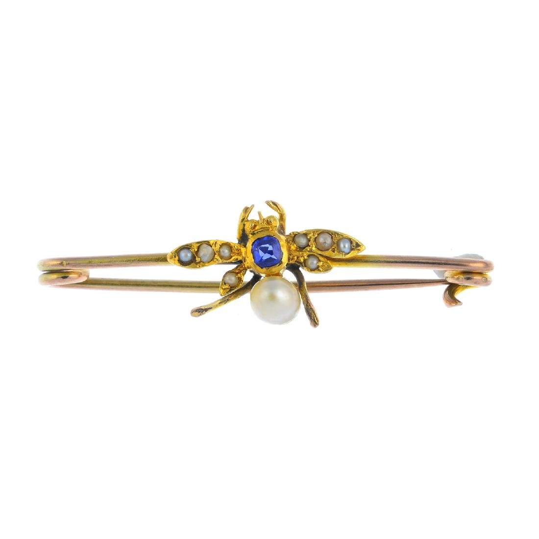A late Victorian gold gem-set fly brooch. The