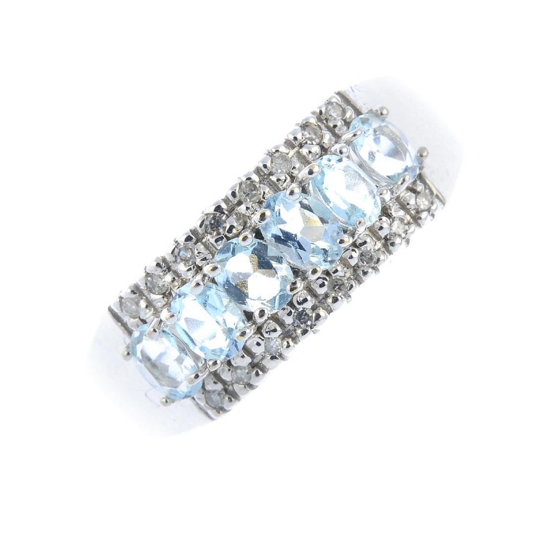 A 9ct gold aquamarine and diamond ring. The oval-shape