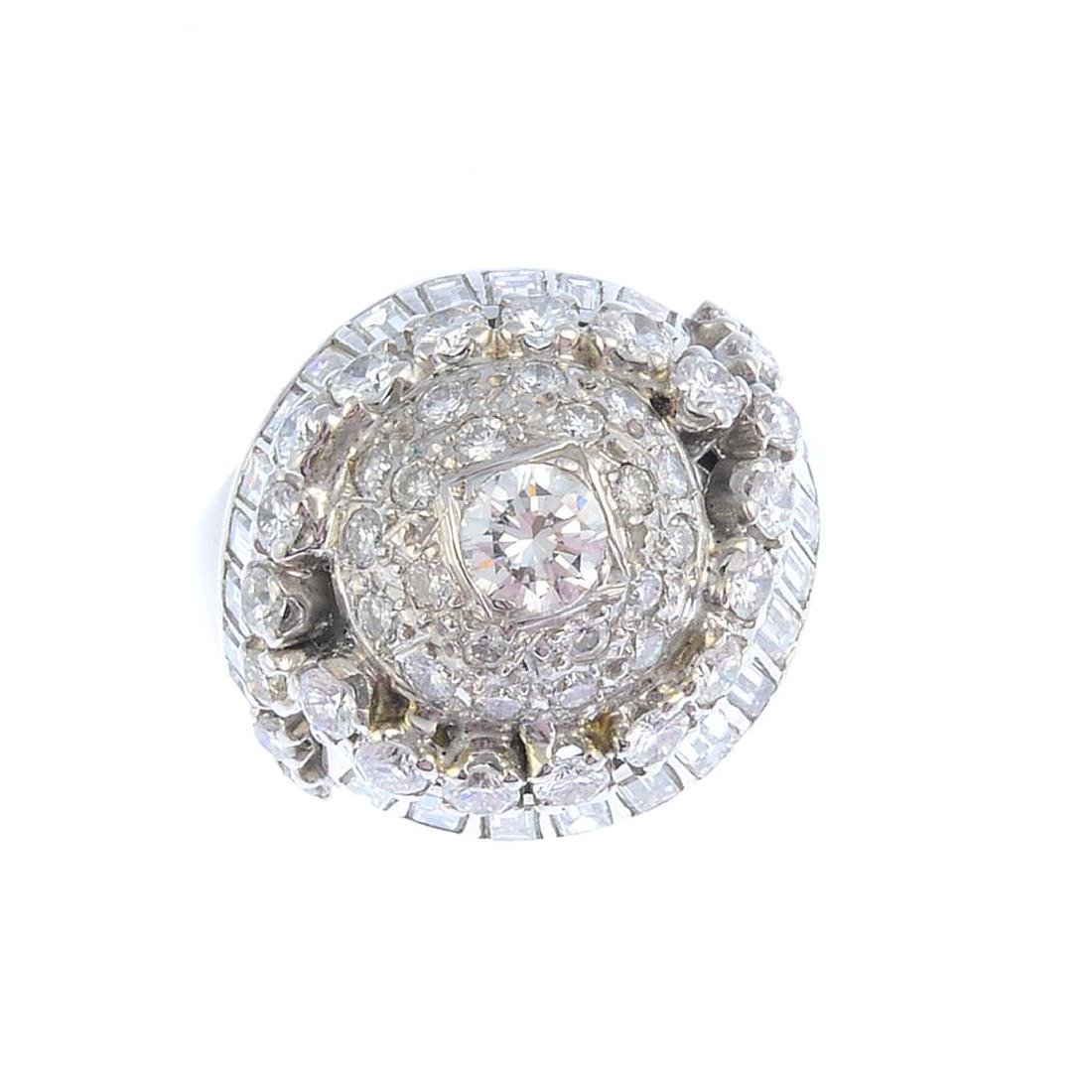 A platinum diamond cocktail ring. Of bombe design, the