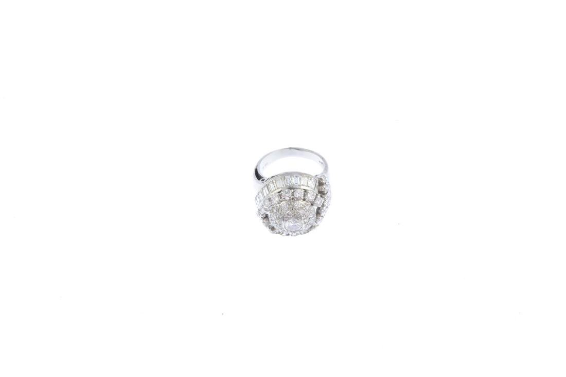 A platinum diamond cocktail ring. Of bombe design, the - 2