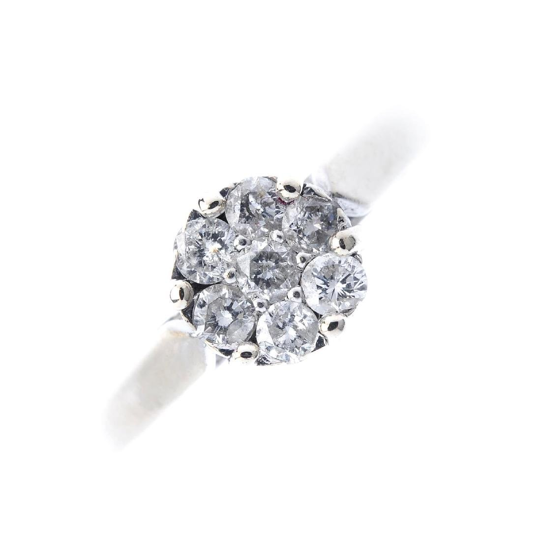 A diamond cluster ring. The brilliant-cut diamond,