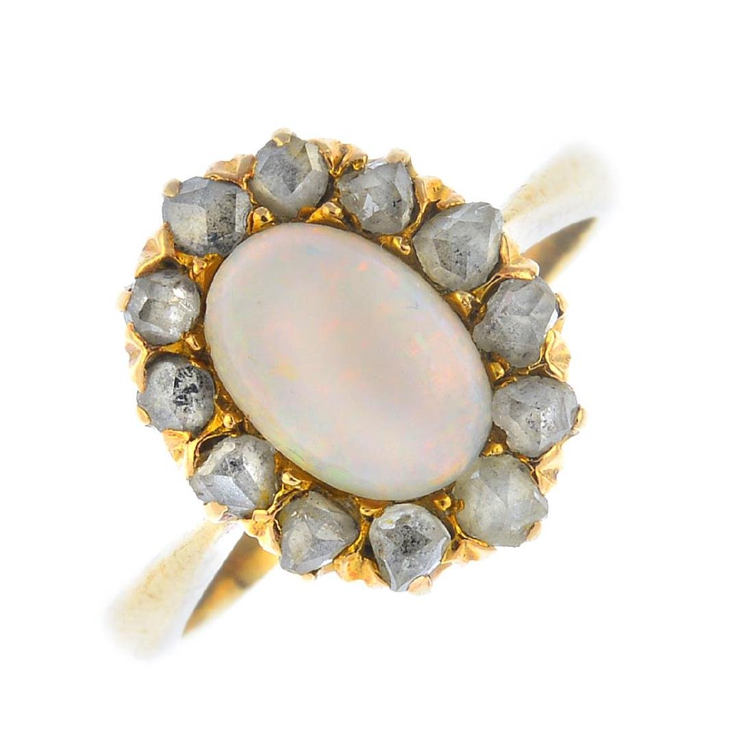An opal and diamond cluster ring. The oval opal