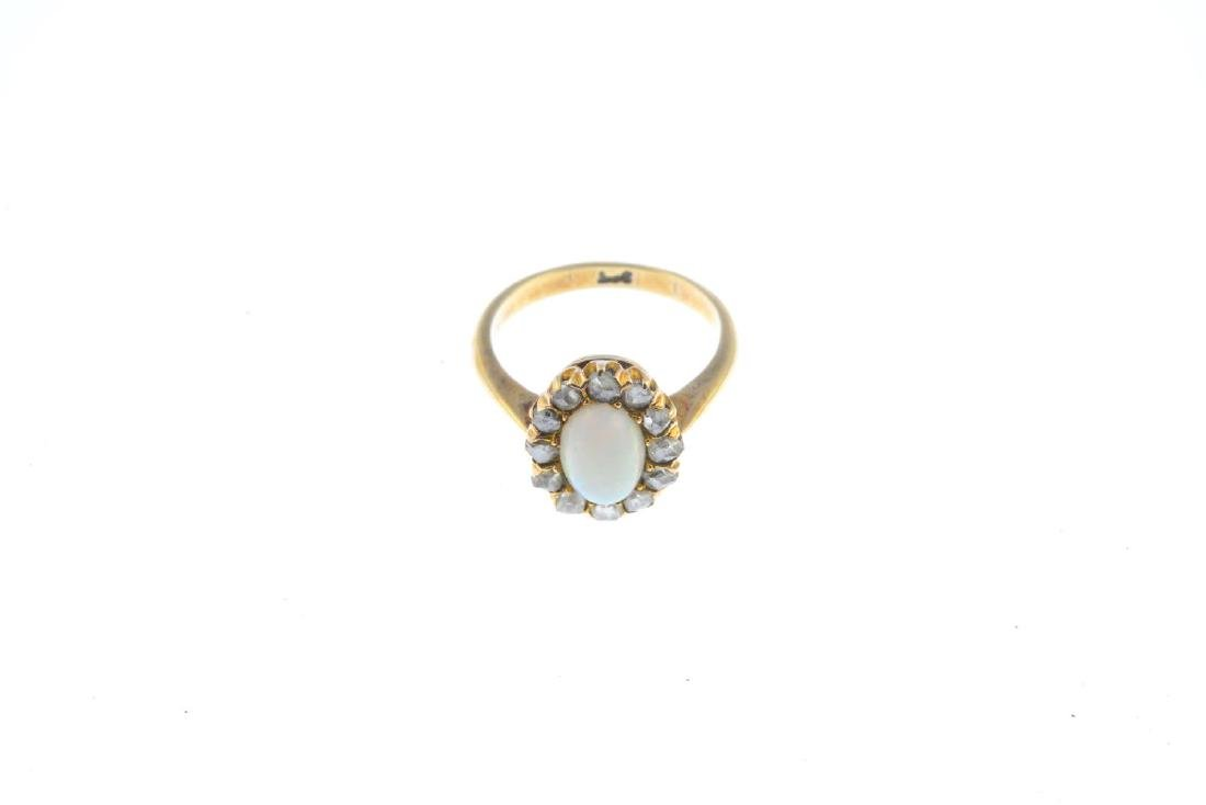 An opal and diamond cluster ring. The oval opal - 2