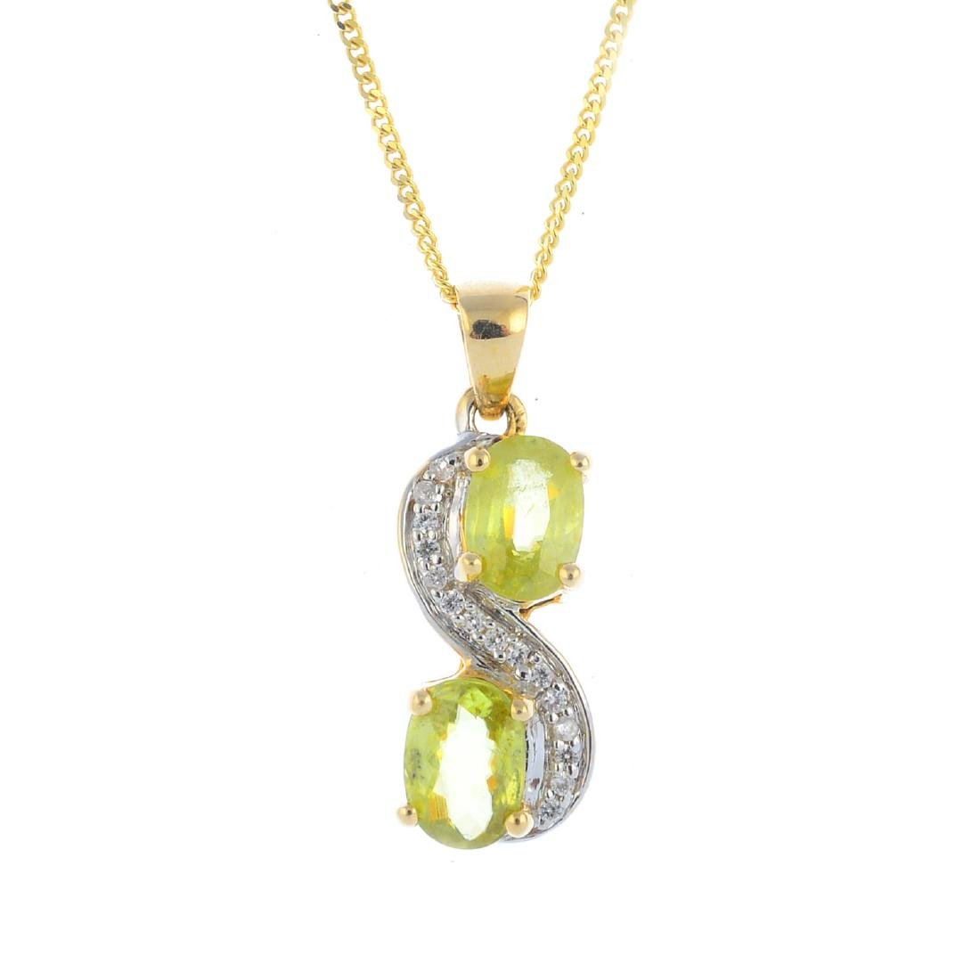 A 9ct gold sphene and cubic zirconia pendant. Designed