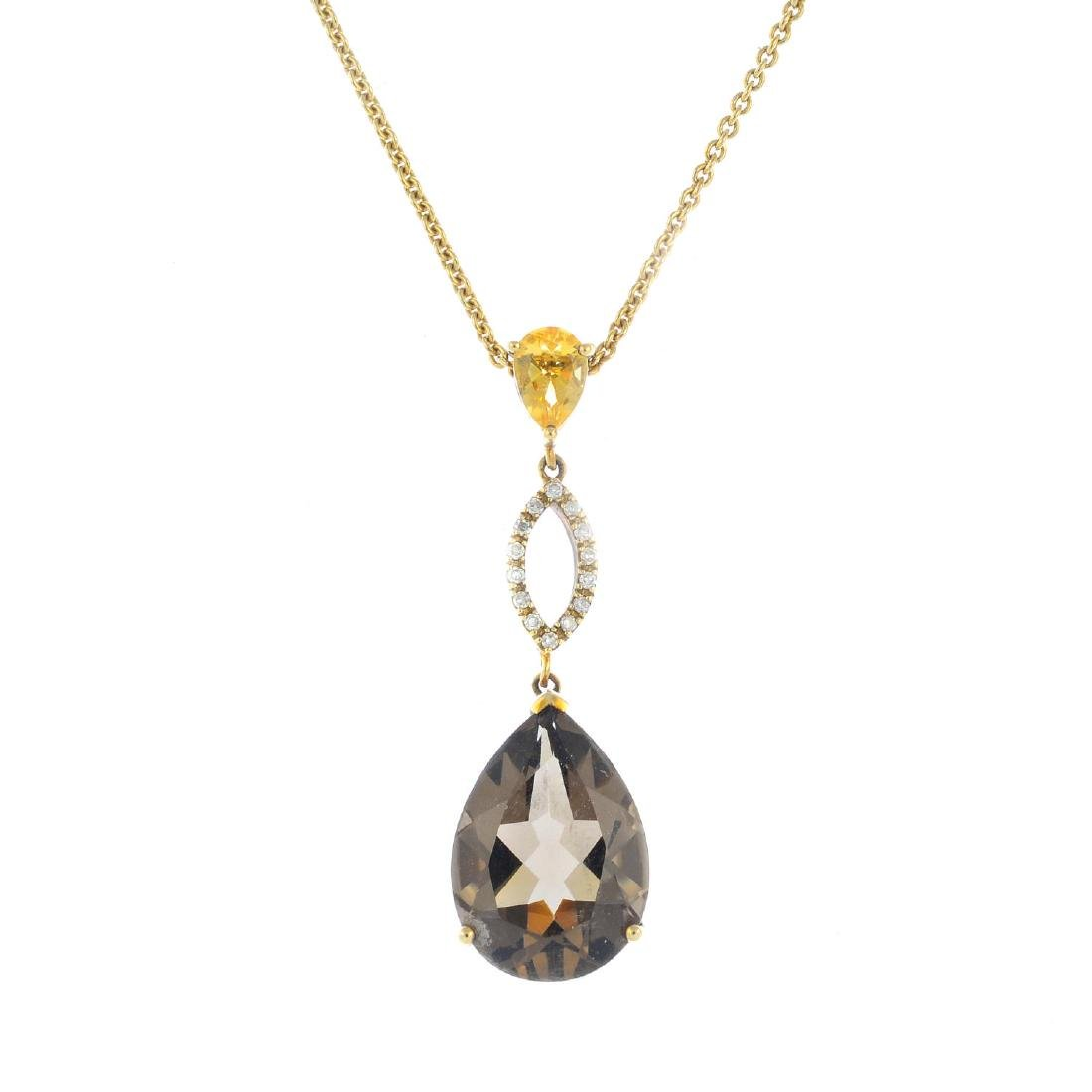 A set of 9ct gold smoky quartz jewellery. To include a
