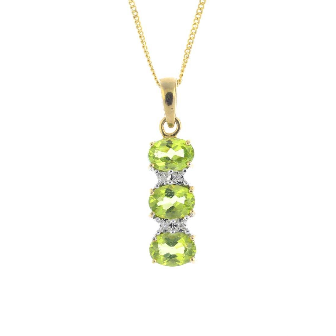 A 9ct gold diamond and peridot pendant. The oval-shape