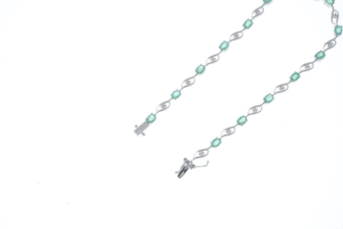 An 18ct gold emerald and diamond bracelet. Designed as - 3