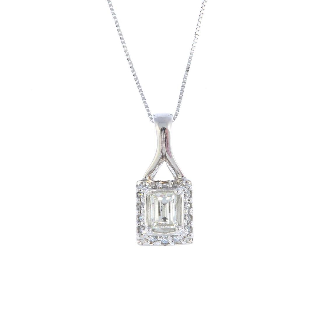 An 18ct gold diamond pendant. The rectangular-shape