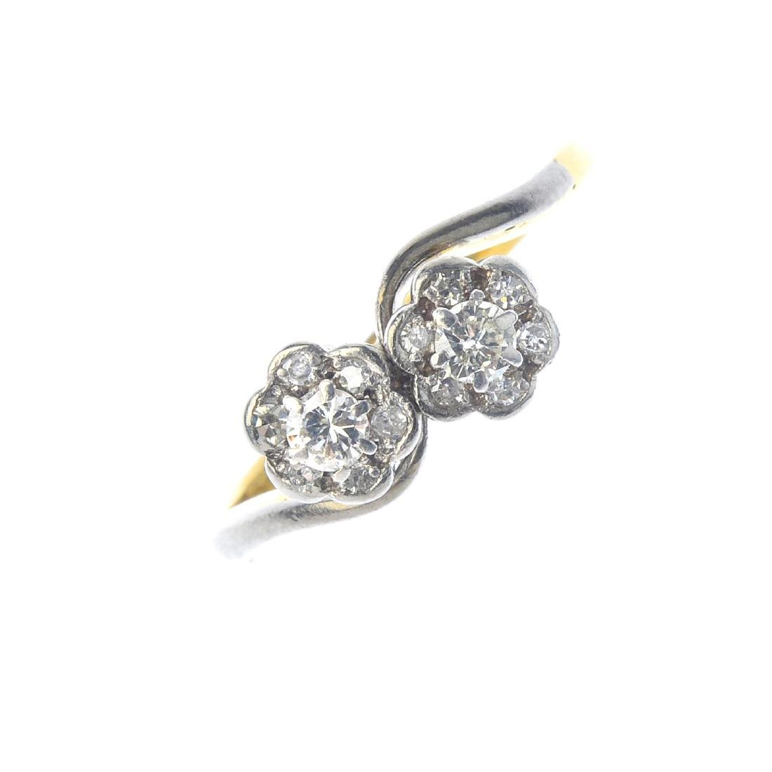 An 18ct gold diamond cluster ring. Designed as a floral