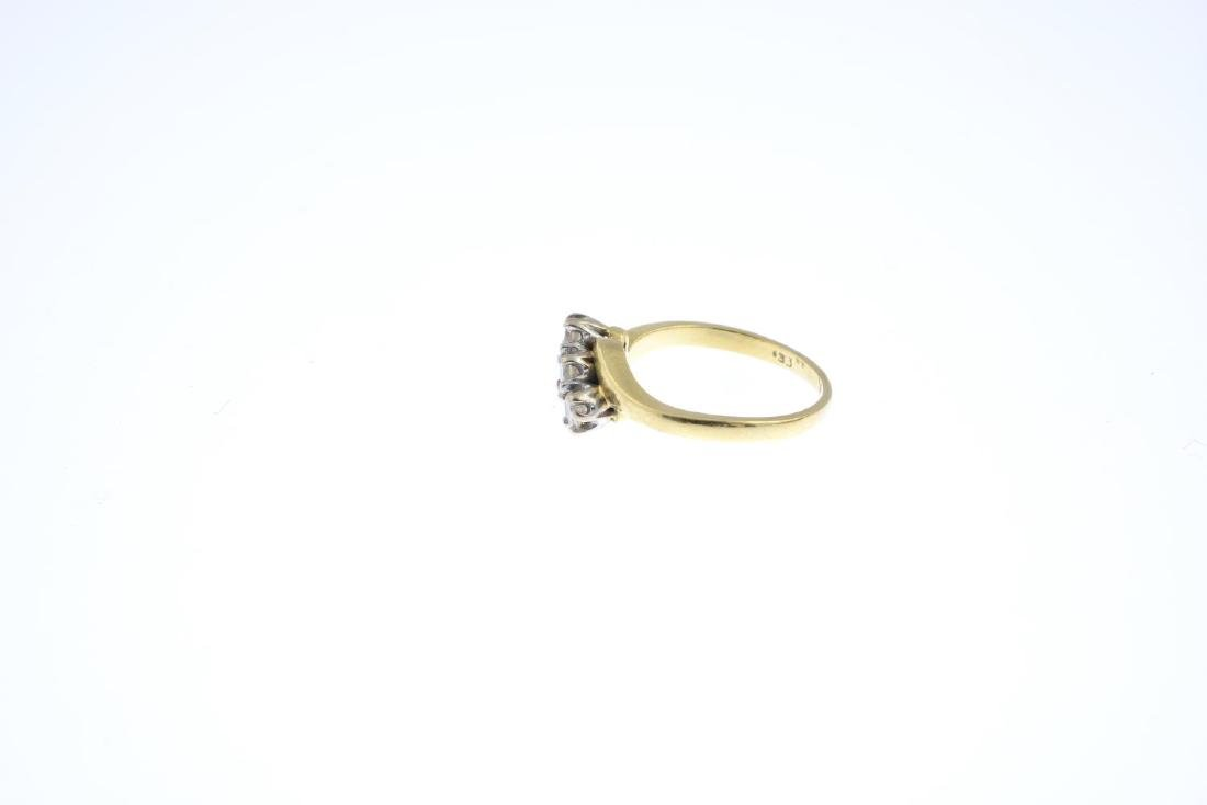 An 18ct gold diamond three-stone ring. The - 2