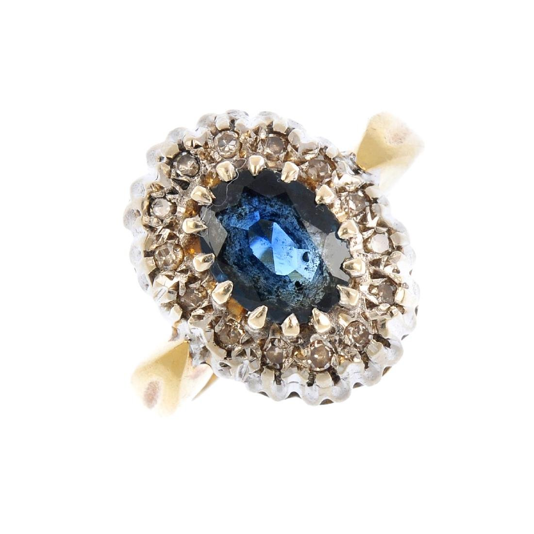 An 18ct gold sapphire and diamond cluster ring. The