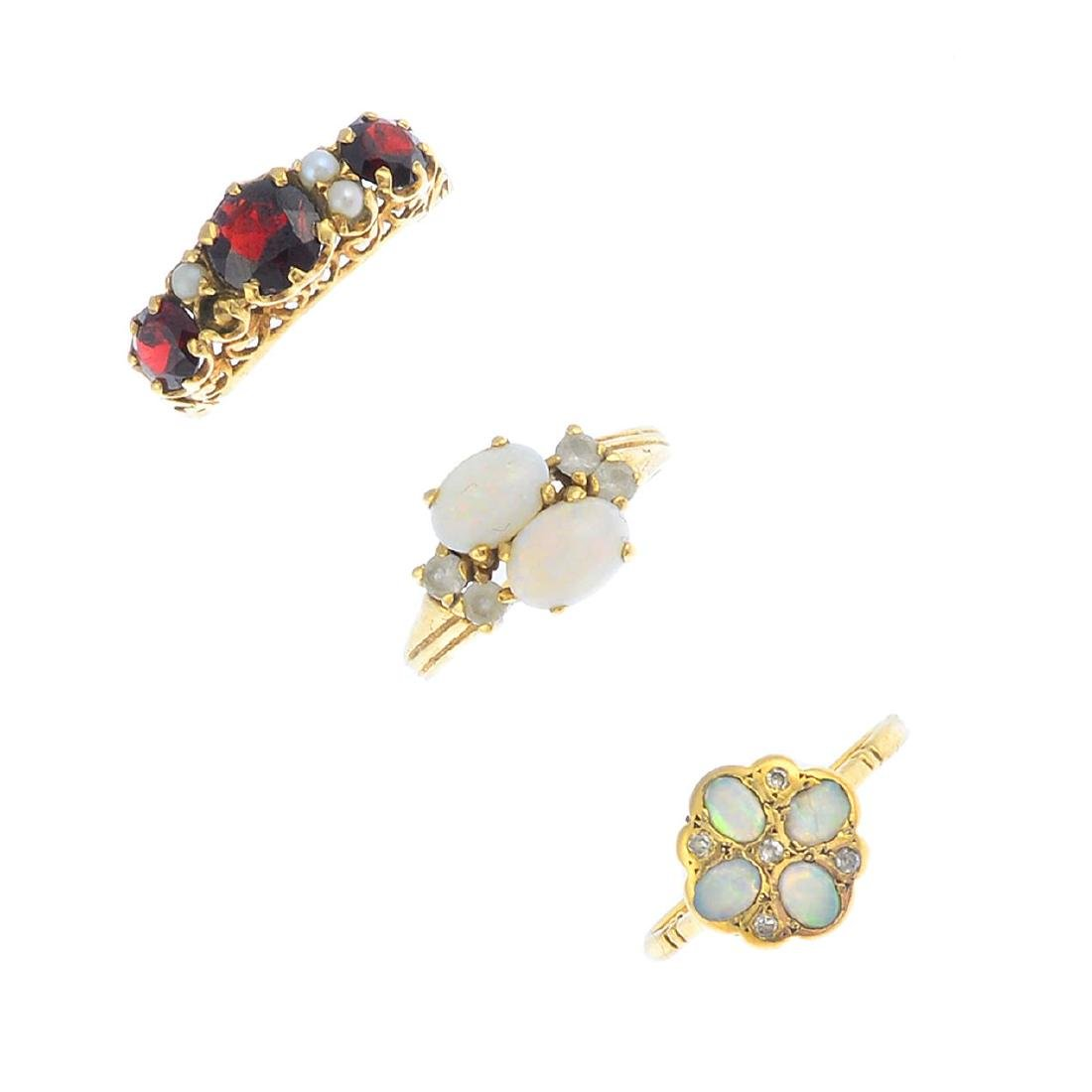 Six gem-set rings. To include a 9ct gold opal and