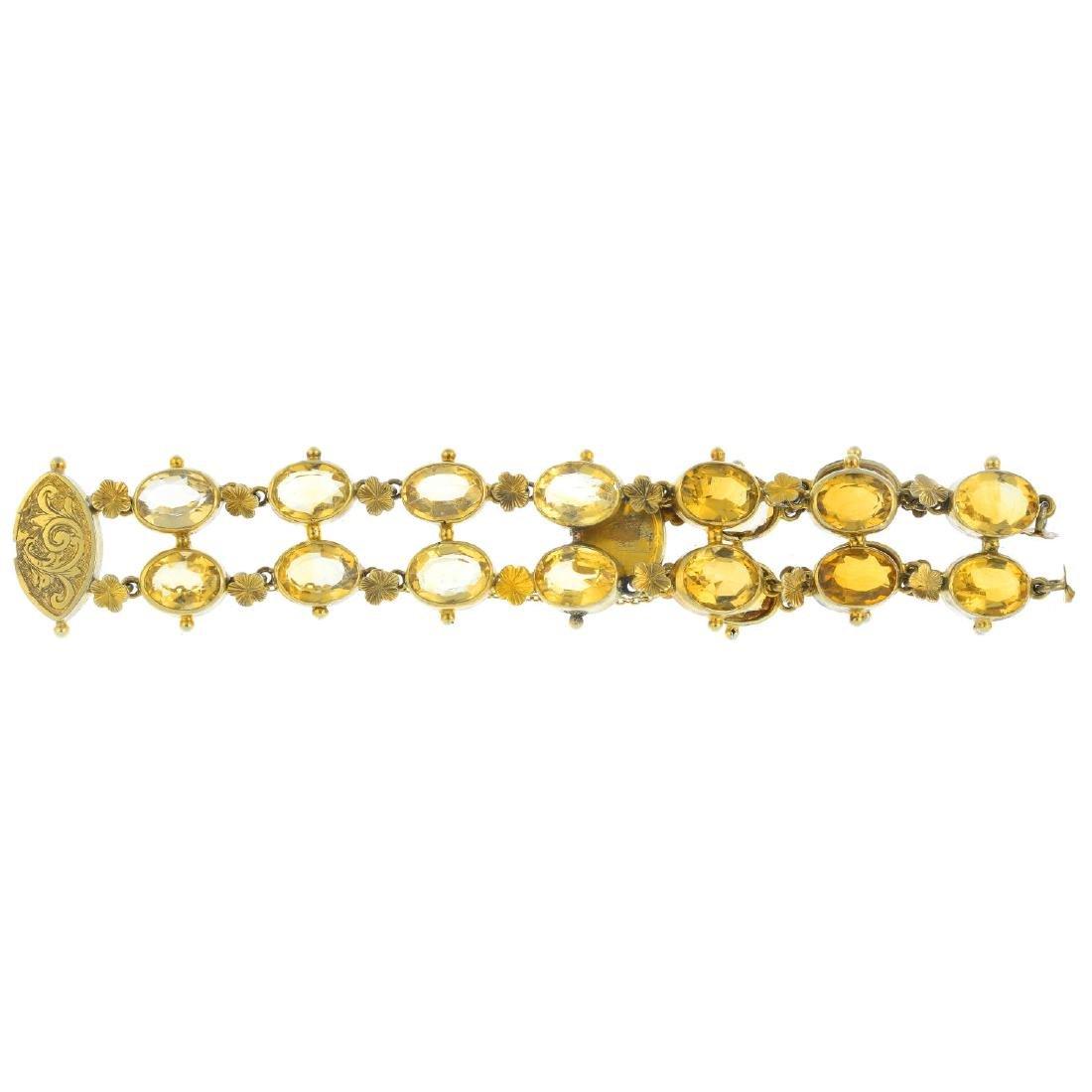 A citrine bracelet. Designed as a series of oval-shape