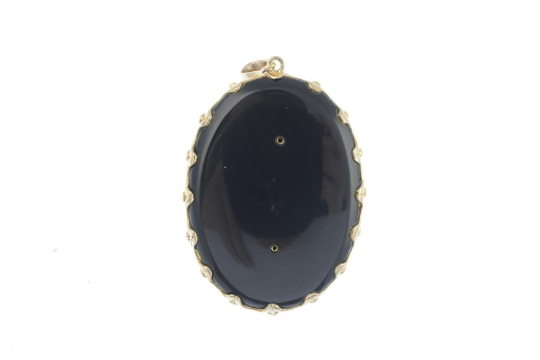 A 9ct gold onyx and diamond pendant. Designed as a lady - 2