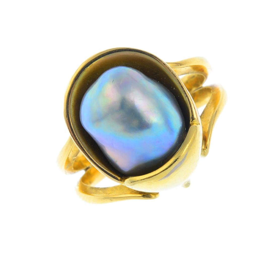 An 18ct gold cultured pearl dress ring. The baroque