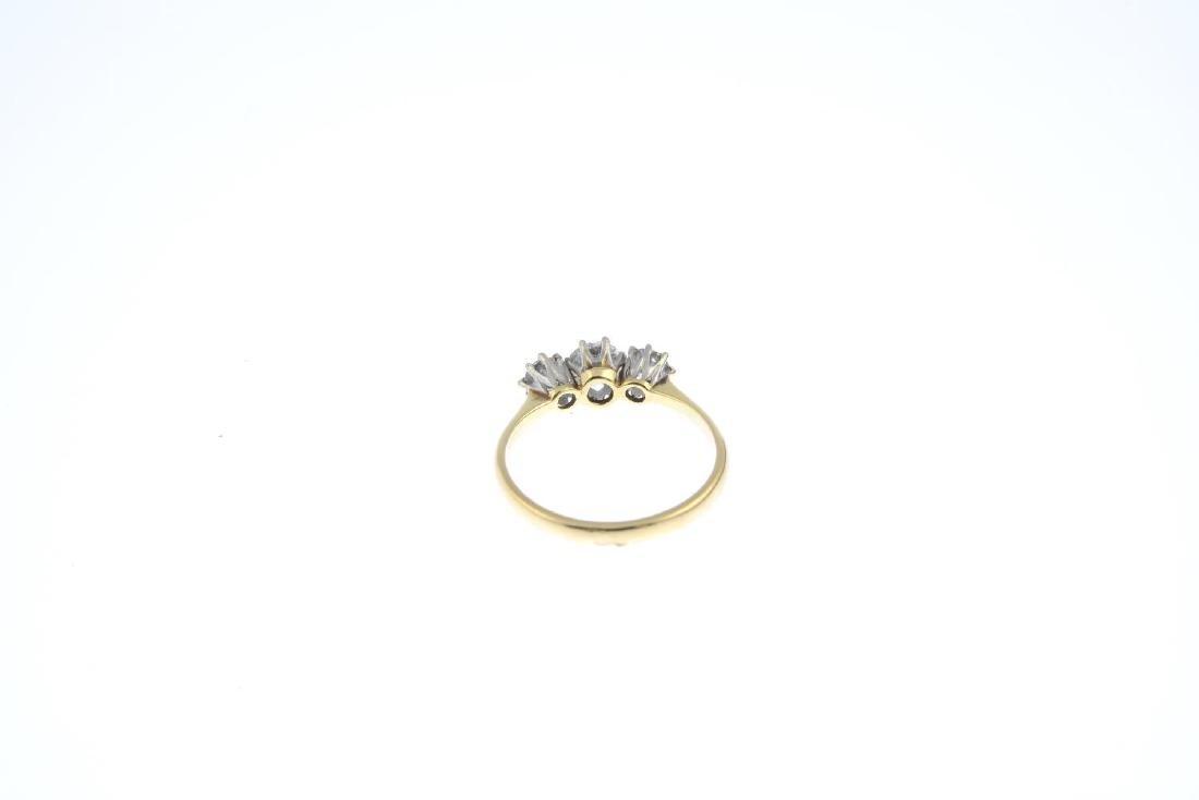 A diamond three-stone ring. The graduated circular-cut - 3