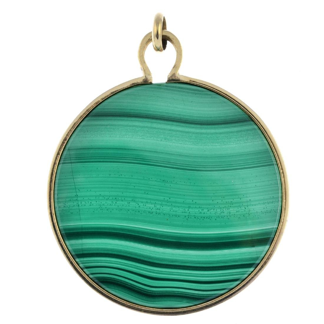 A 1970s 9ct gold malachite pendant. The circular