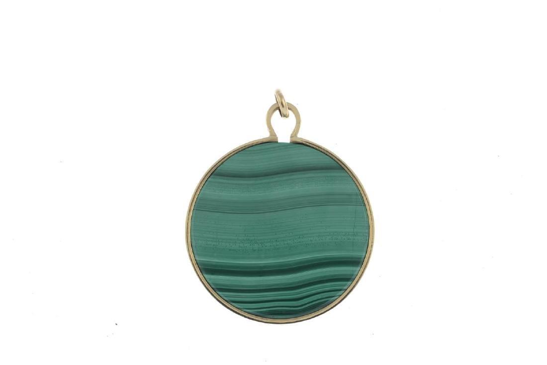 A 1970s 9ct gold malachite pendant. The circular - 2