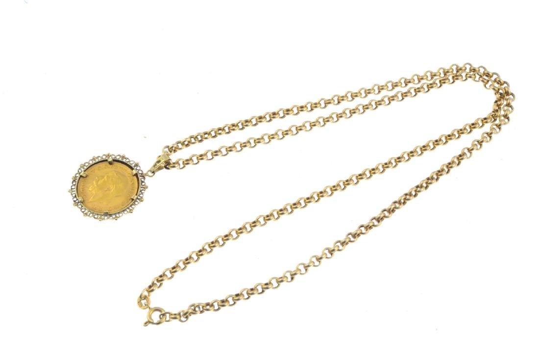 A 9ct gold half sovereign pendant. The half sovereign, - 2