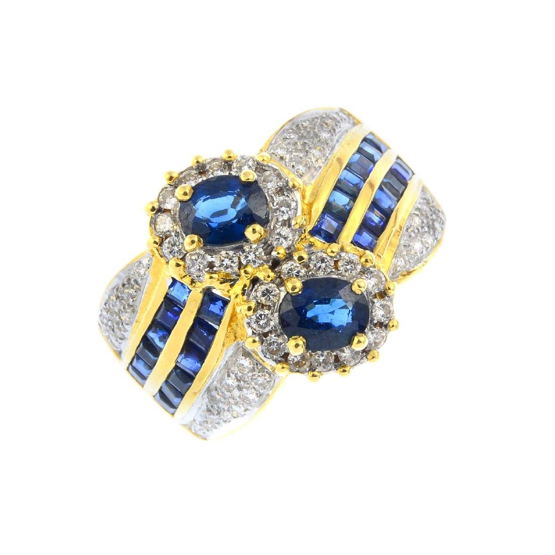 An 18ct gold sapphire and diamond dress ring. Of