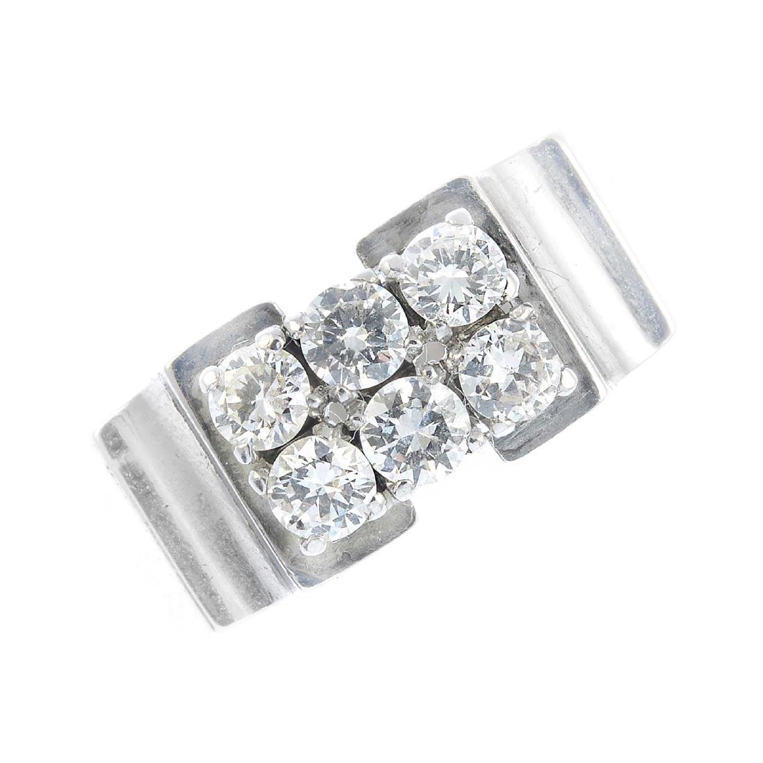 A diamond dress ring. Designed as two rows of three