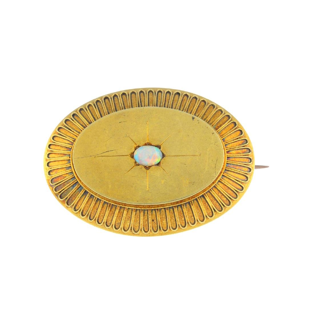 A late Victorian gold opal brooch. The oval opal