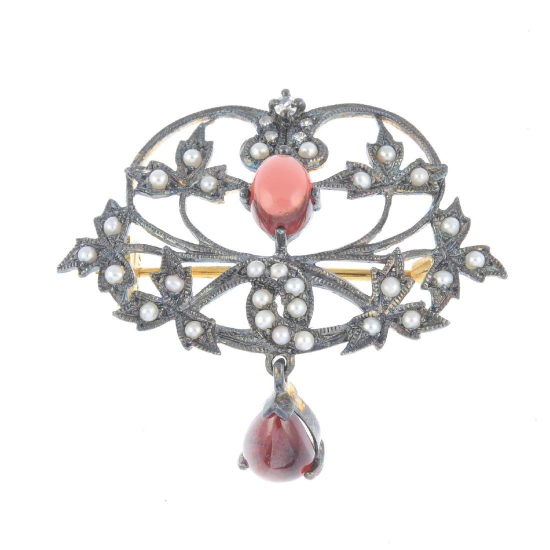 A diamond, garnet and seed pearl brooch. Of openwork