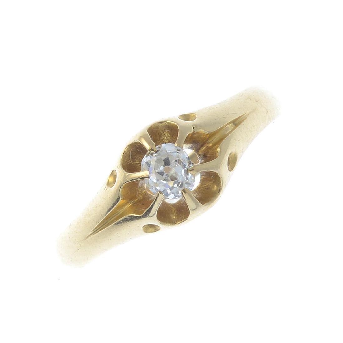 A diamond single-stone ring. The old-cut diamond, with