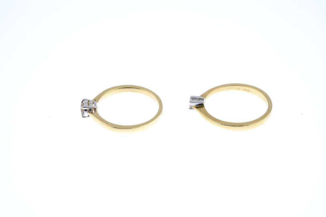 Two gold diamond single-stone rings. To include an 18ct - 2