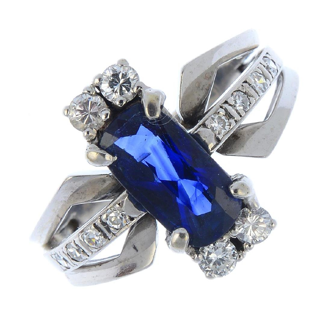 A sapphire and diamond dress ring. The