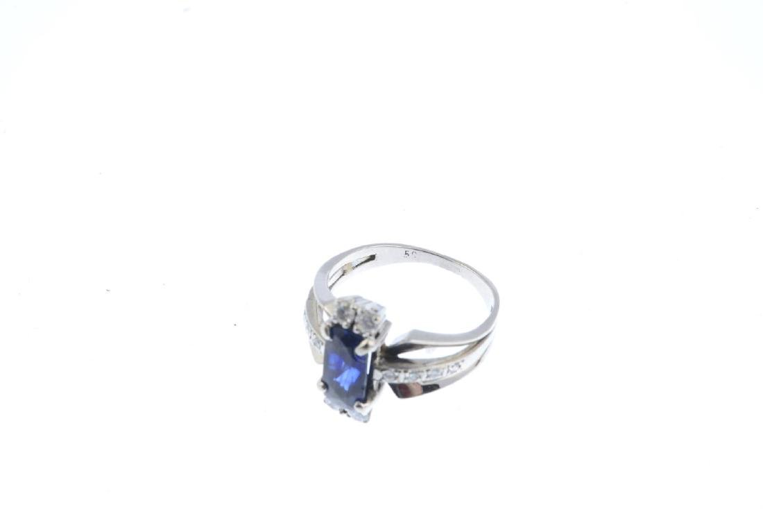 A sapphire and diamond dress ring. The - 2
