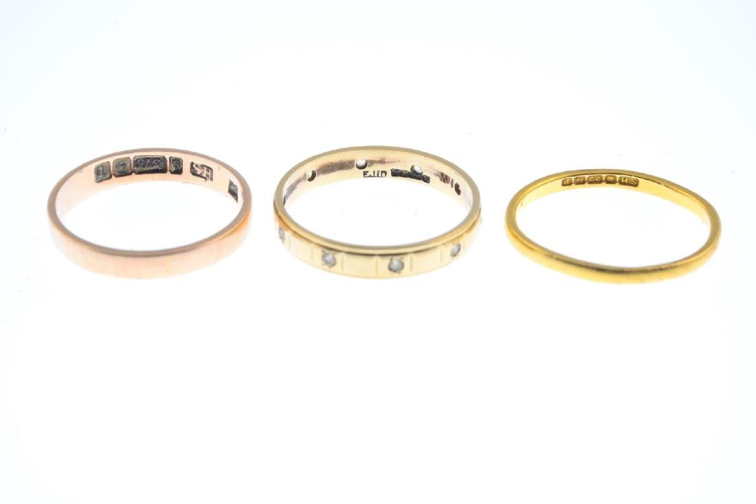 Three gold band rings. To include a 22ct gold plain - 2