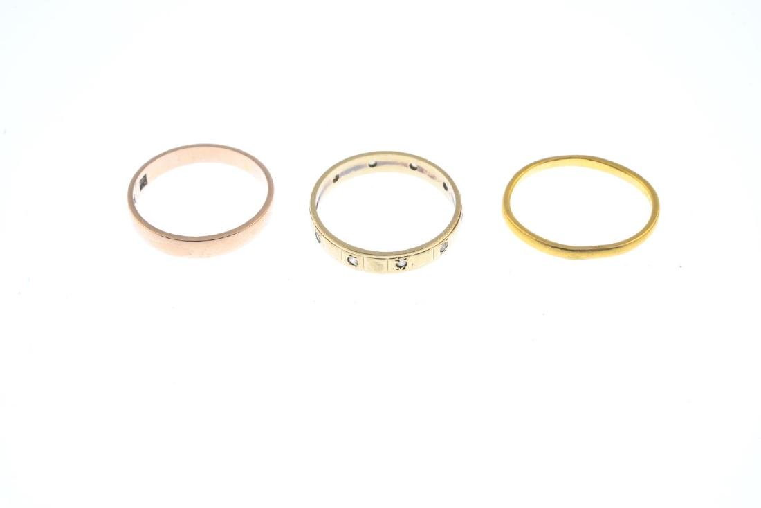 Three gold band rings. To include a 22ct gold plain - 3
