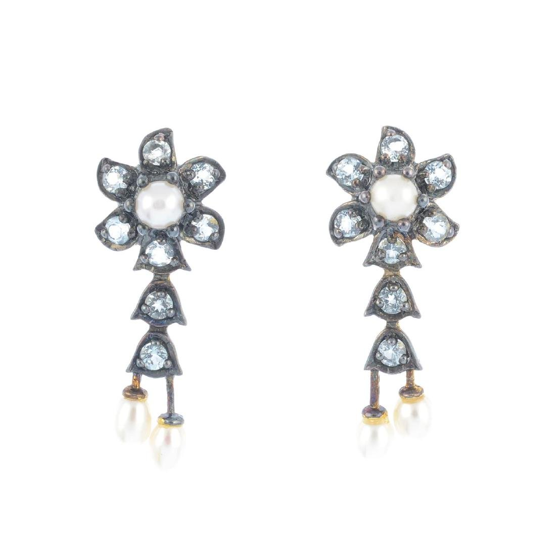 A pair of cultured pearl and cubic zirconia earrings.