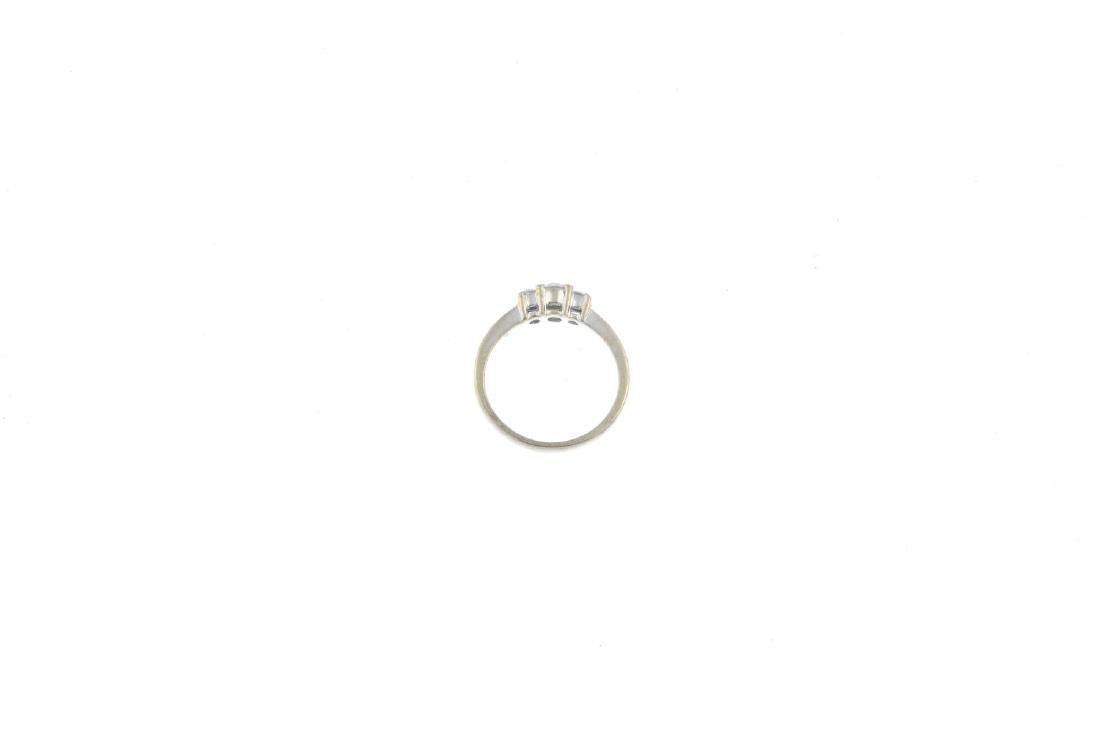 A 9ct gold diamond three-stone ring. The graduated - 2