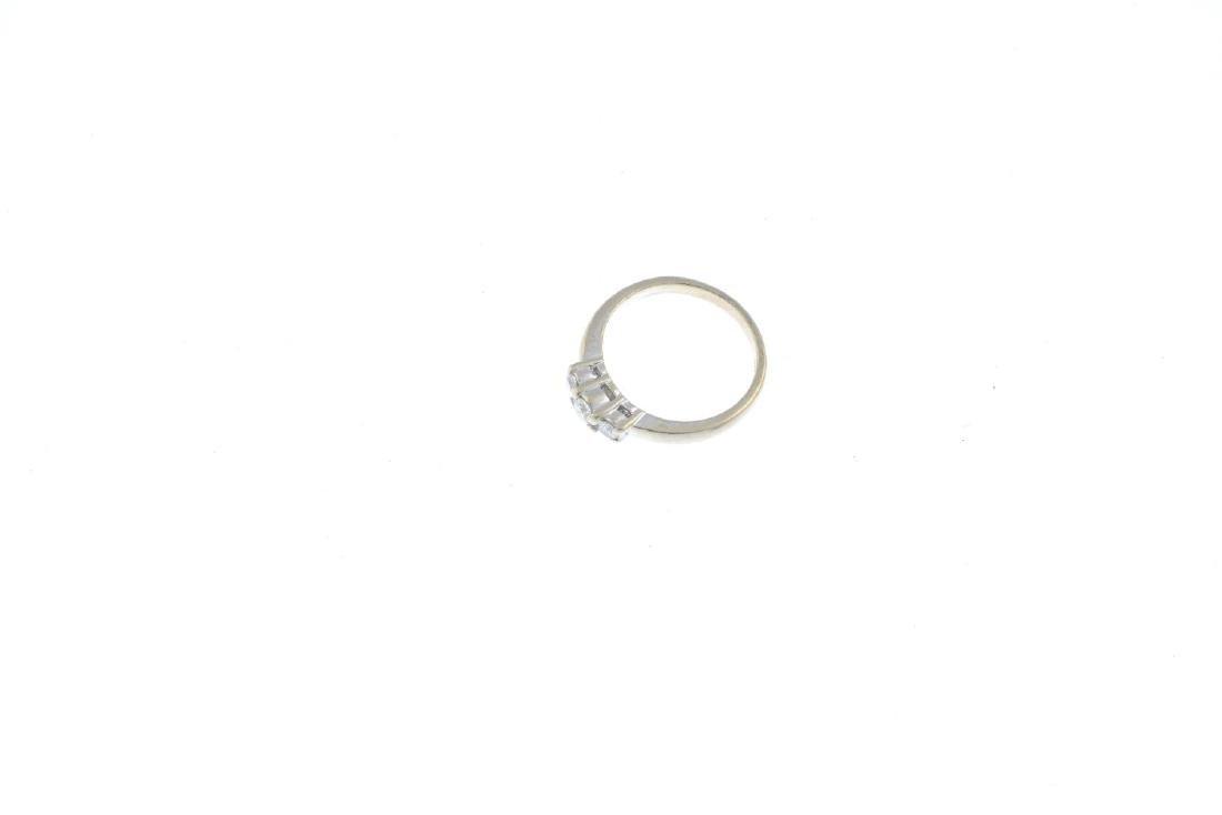 A 9ct gold diamond three-stone ring. The graduated - 3