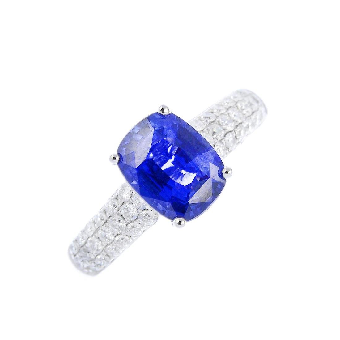 A sapphire and diamond single-stone ring. The