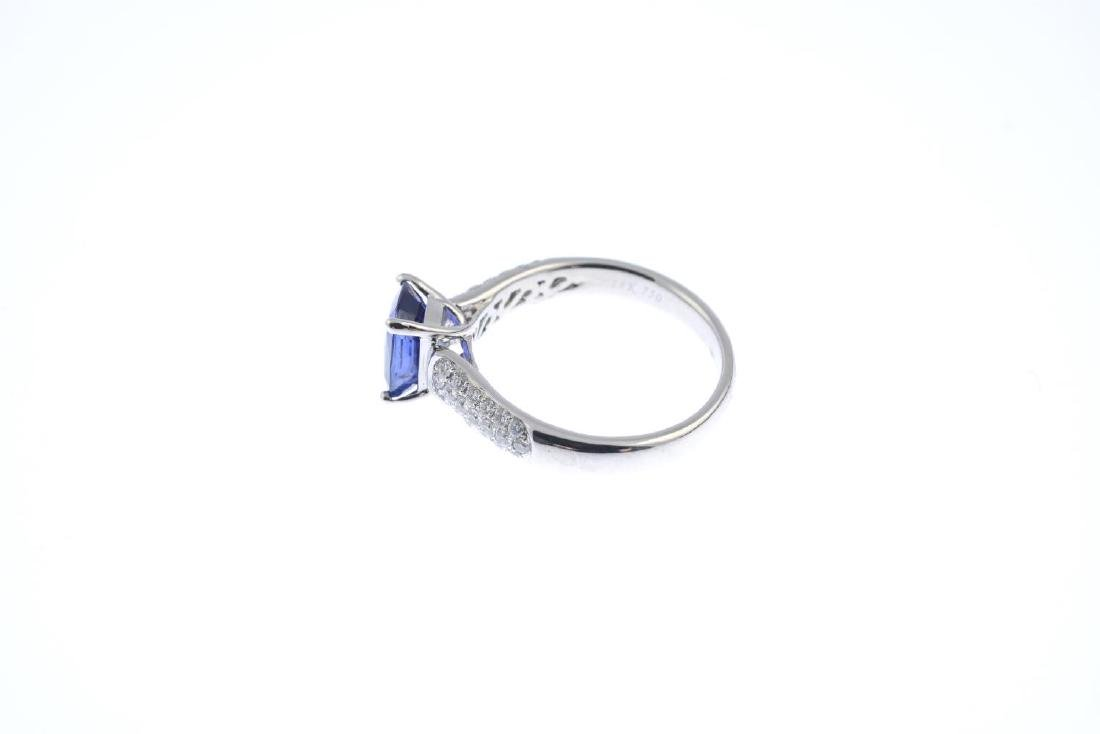 A sapphire and diamond single-stone ring. The - 2