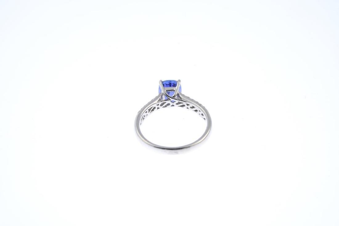 A sapphire and diamond single-stone ring. The - 3