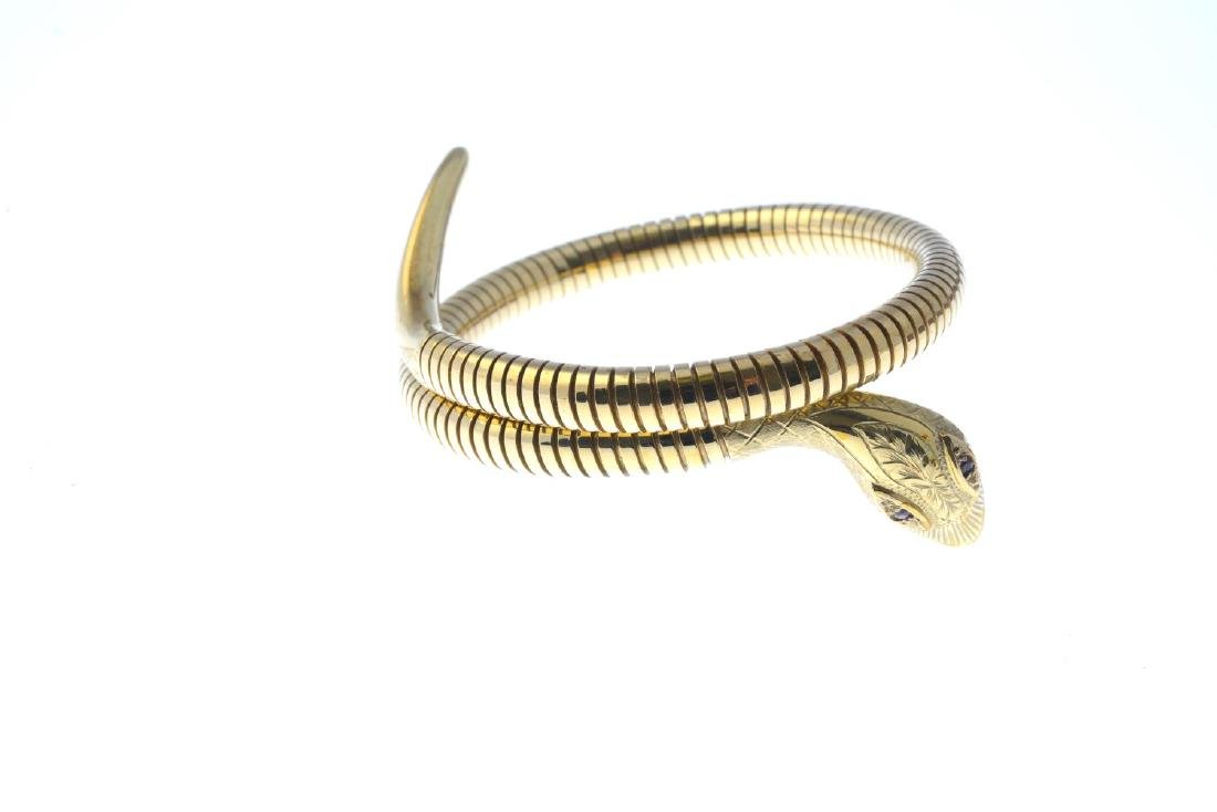 A 9ct gold flexible snake bangle. Designed as a coiled - 2