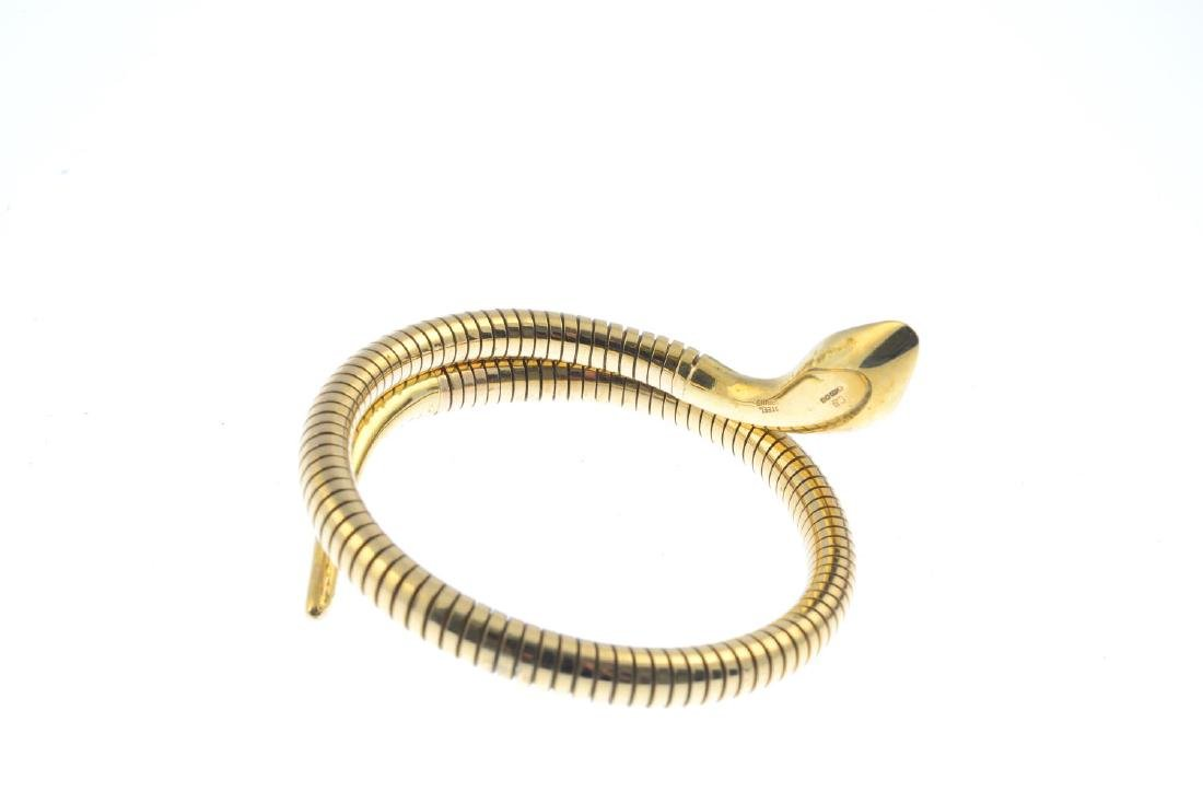 A 9ct gold flexible snake bangle. Designed as a coiled - 3