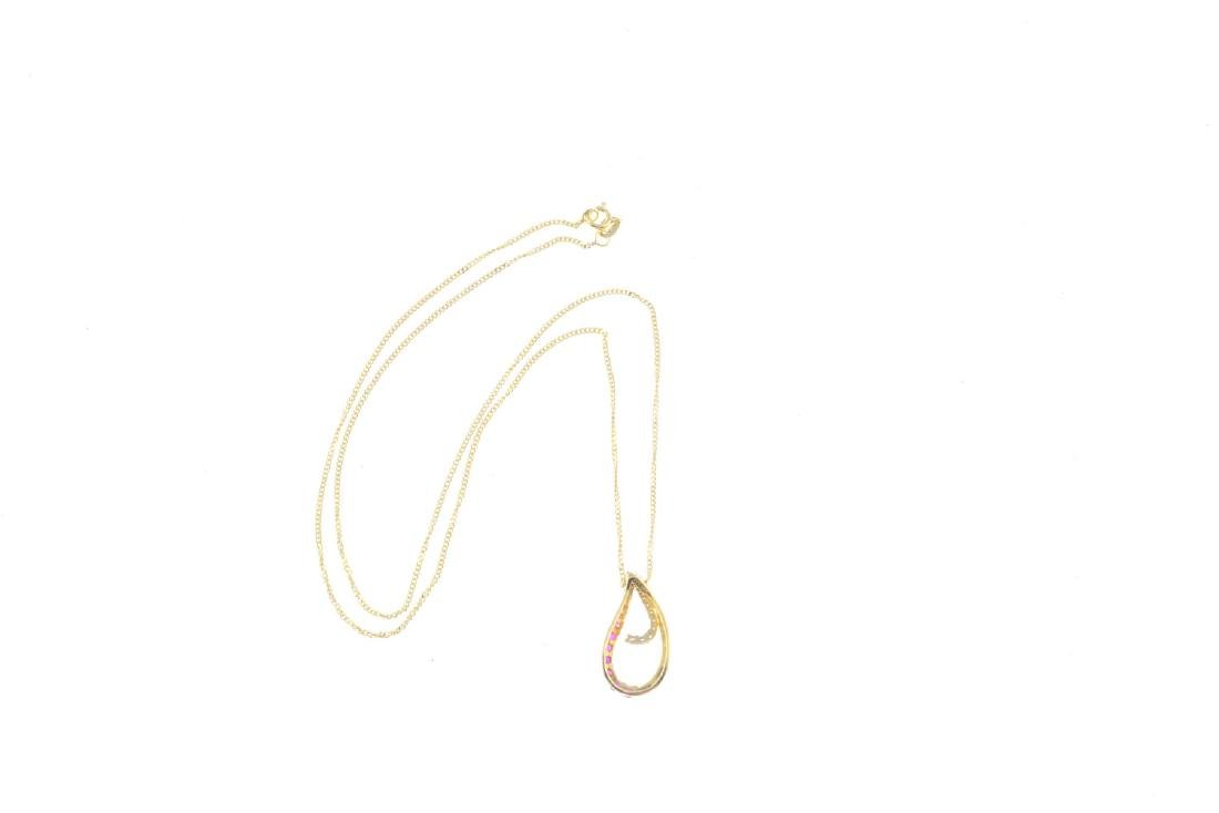 A 9ct gold ruby and diamond pendant. The graduated - 2
