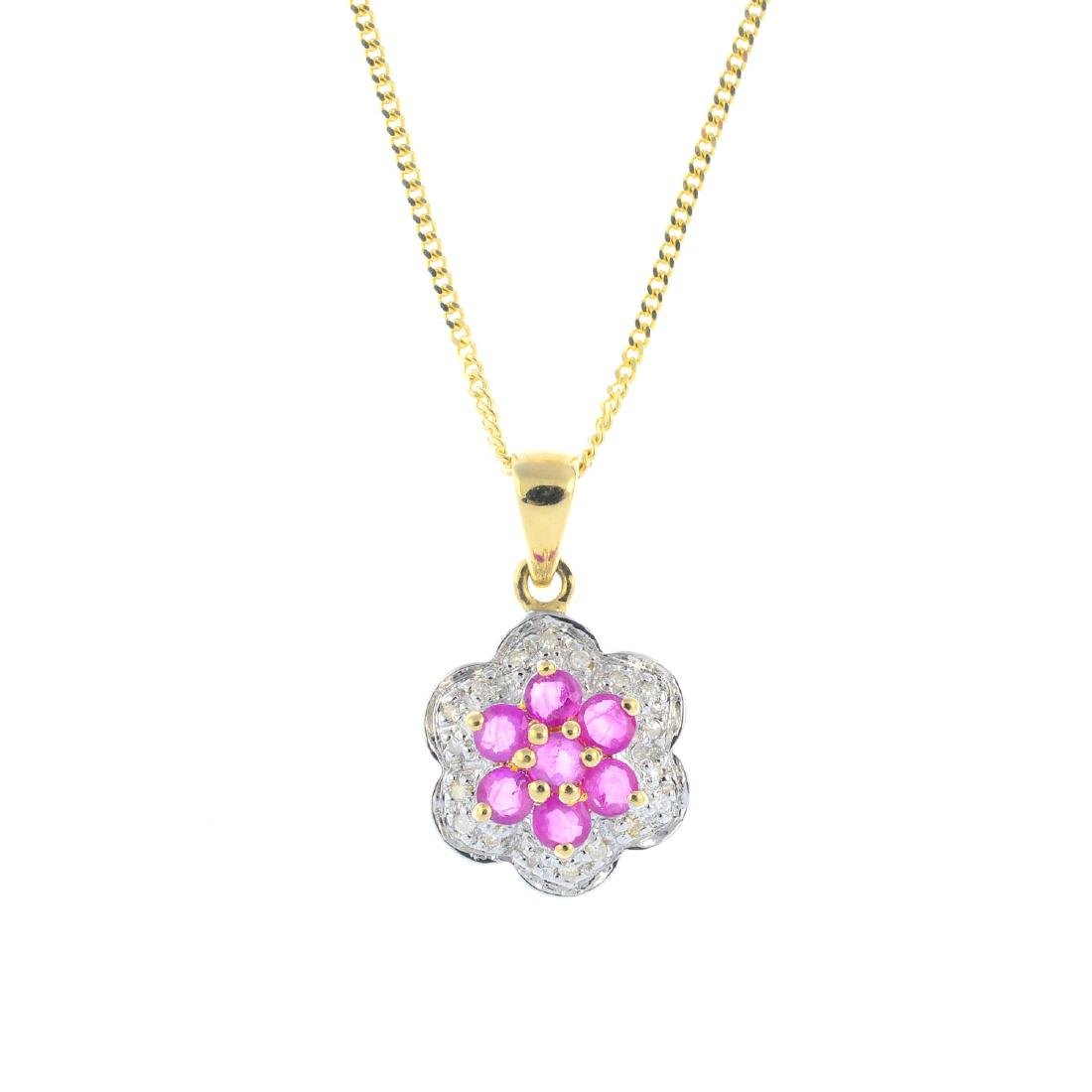 A 9ct gold ruby and diamond cluster pendant. The