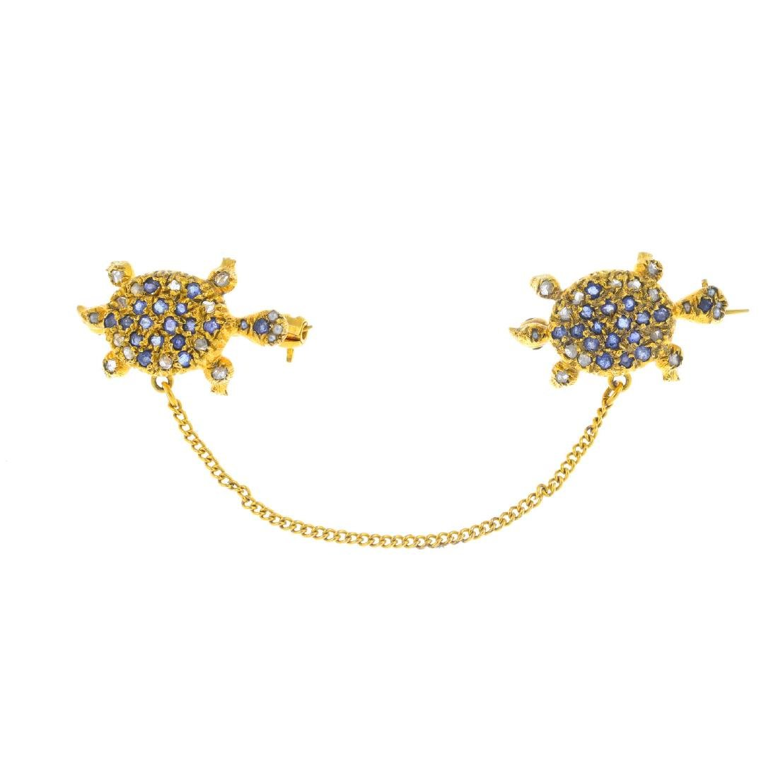A sapphire, diamond and split pearl brooch. Designed as