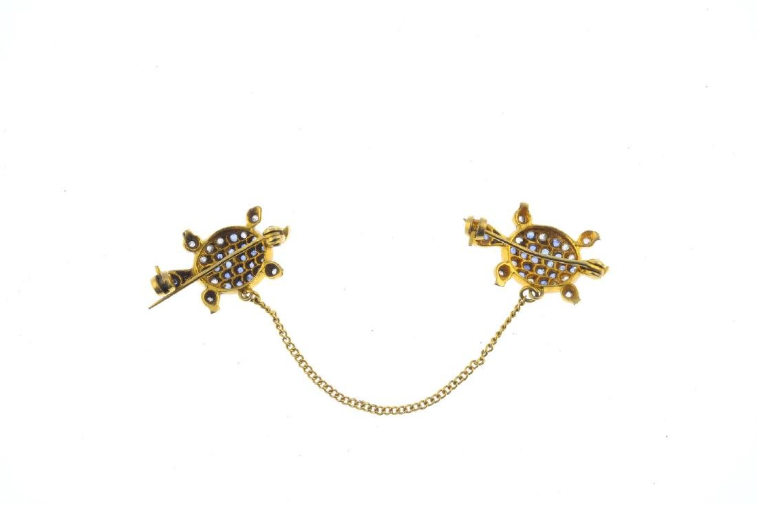 A sapphire, diamond and split pearl brooch. Designed as - 2