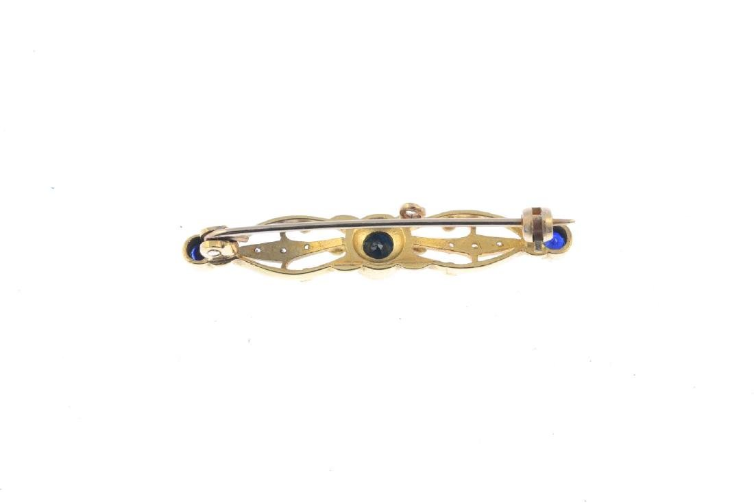 A 9ct gold sapphire and diamond brooch. Of openwork - 2