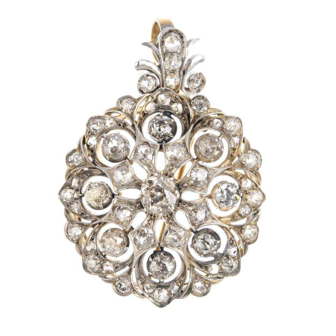 An early 20th century diamond floral pendant. Of