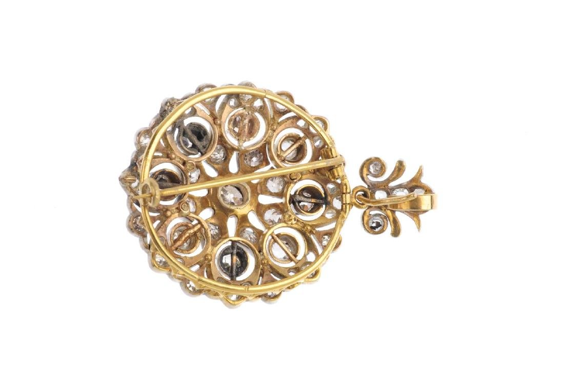 An early 20th century diamond floral pendant. Of - 2
