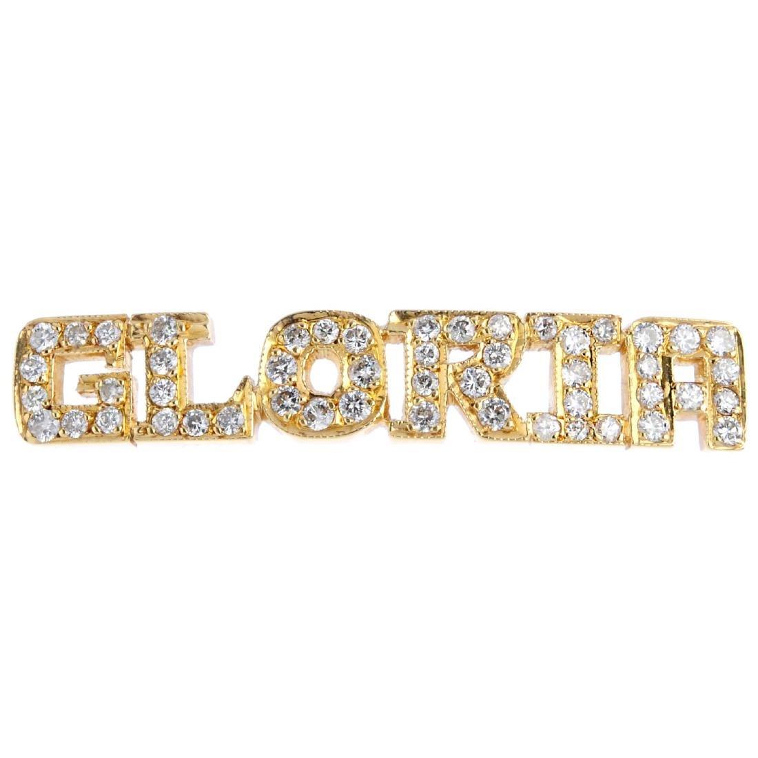 A diamond nameplate. The brilliant-cut diamond script